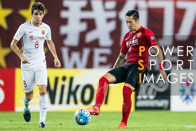 Guangzhou Midfielder Xu Xin (R) in action against Shanghai FC Forward Oscar Emboaba Junior (L) during the AFC Champions League 2017 Quarter-Finals match between Guangzhou Evergrande (CHN) vs Shanghai SIPG (CHN) at the Tianhe Stadium on 12 September 2017 in Guangzhou, China. Photo by Marcio Rodrigo Machado / Power Sport Images