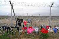 Idomeni / Greece 03/04/2016<br /> Refugee Camp in Idomeni.<br /> Clothes put out to dry on the barbed wire that separates the greek border from the republic of Macedonia.<br /> Photo Livio Senigalliesi