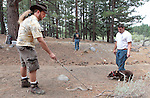 Snake-handler John Potash, left, and dog trainers Willie Stevens, center, and Nick Shanton take Brandi through snake-avoidance training at Davis Creek Park in Washoe Valley, Nev., on Saturday Aug. 18, 2012.  .Photo by Cathleen Allison