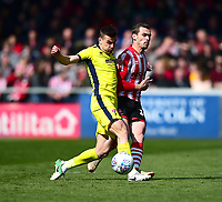 Lincoln City's Harry Toffolo battles with  Cheltenham Town's Kevin Dawson<br /> <br /> Photographer Andrew Vaughan/CameraSport<br /> <br /> The EFL Sky Bet League Two - Lincoln City v Cheltenham Town - Saturday 13th April 2019 - Sincil Bank - Lincoln<br /> <br /> World Copyright © 2019 CameraSport. All rights reserved. 43 Linden Ave. Countesthorpe. Leicester. England. LE8 5PG - Tel: +44 (0) 116 277 4147 - admin@camerasport.com - www.camerasport.com