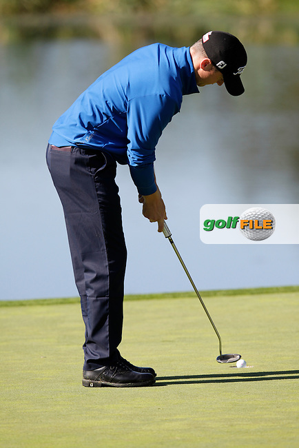 Michael Hoey (NIR) putts on the 4th green during Thursday's Round 1 of the 2014 Open de Espana held at the PGA Catalunya Resort, Girona, Spain. Wednesday 15th May 2014.<br /> Picture: Eoin Clarke www.golffile.ie
