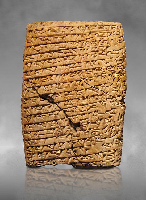 Hittite cuneiform tablet. Adana Archaeology Museum, Turkey. Against a grey art background