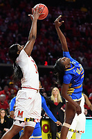 College Park, MD - March 25, 2019: Maryland Terrapins forward Brianna Fraser (34) catches a pass just over the head of UCLA Bruins forward Michaela Onyenwere (21) during second round game of NCAAW Tournament between UCLA and Maryland at Xfinity Center in College Park, MD. UCLA advanced to the Sweet 16 defeating Maryland 85-80.(Photo by Phil Peters/Media Images International)