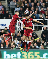 Liverpool's Roberto Firmino and Dominic Solanke battle with Newcastle United's Ciaran Clark<br /> <br /> Photographer Rich Linley/CameraSport<br /> <br /> The Premier League -  Newcastle United v Liverpool - Sunday 1st October 2017 - St James' Park - Newcastle<br /> <br /> World Copyright &copy; 2017 CameraSport. All rights reserved. 43 Linden Ave. Countesthorpe. Leicester. England. LE8 5PG - Tel: +44 (0) 116 277 4147 - admin@camerasport.com - www.camerasport.com