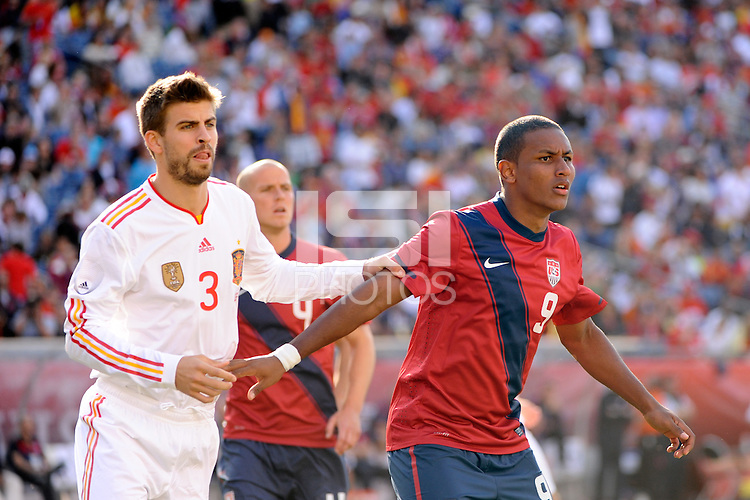 Gerard Pique (3) of Spain and Juan Agudelo (9) of the United States. The men's national team of Spain (ESP) defeated the United States (USA) 4-0 during a International friendly at Gillette Stadium in Foxborough, MA, on June 04, 2011.