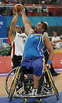 David Eng (rear) of Montreal tries to get off a shot against a defender from Sweden in men's wheelchair basketball action at the Paralympic Games in Beijing,Tuesday, Sept., 9, 2008.    Photo by Mike Ridewood/CPC