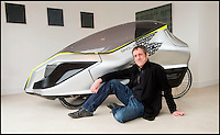 BNPS.co.uk (01202 558833)<br /> Pic: PhilYeomans/BNPS<br /> <br /> Grant Sinclair with his reinvented Sinclair.<br /> <br /> The much-maligned Sinclair C5 electric tricycle that fell flat on its face in the 1980s has been reborn by the original inventor's nephew. <br /> <br /> Eccentric businessman Sir Clive Sinclair is famous for some groundbreaking inventions but none more so than his disastrous one person vehicle.<br /> <br /> Sir Clive touted his plastic-covered tricycle as a leap in personal transportation only for it to be reviewed as one of the greatest marketing bombs of post-war Britain. <br /> <br /> Grant Sinclair has kept faith in his uncle's memorable design and has spent the last four years reimagining it in the hope his fairs better in a world where bike lanes are common place.