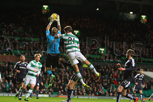 02.03.2016. Celtic Park, Glasgow, Scotland. Scottish Premier League. Celtic versus Dundee. Dundee keeper Scott Bain is challenged by Charlie Mulgrew for the crossed ball