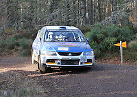 Barry Groundwater - Neil Shanks in a Mitsubishi Lancer Evolution 9 competing at Junction 6 on the Munro Scotch Beef Millbuie Special Stage 1 on the 2014 Arnold Clark/Thistle Hotel Snowman Rally, supported by Highland Office Equipment, part of Capital Document Solutions which was organised by Highland Car Club and based in Inverness on 22.2.14; Round 1 of the 2014 RAC MSA Scottish Rally Championship sponsored by ARR Craib Transport Limited.