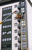 Pictured: Workers on a cherry picker remove cladding panels from Kennedy Gardens flats in Billingham. Tuesday 27 June 2017<br />