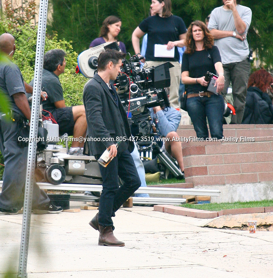 November 10th 2011  ..Colin Farrell filming his new movie called Seven Psychopaths in Los Angeles. Colin was holding & drinking a bottle of hard liquor for the scene ..AbilityFilms@yahoo.com.805-427-3519.www.AbilityFilms.com..