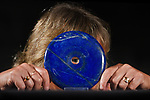 Pictured: Letty Stiles, 56, peering through an unusual lapis lazuli disc at Summer Place Auction, Billingshurst. It is estimated to be worth between £800 - £1200.<br /> <br /> Summers Place Auctions who have turned to online auctions for the first time in their history due to the coronavirus lockdown restrictions hope to return to the auction house once again in September.<br /> <br /> The minerals auction includes obelisks, boxes and freeform minerals made from lapis lazuli as well a variety of other minerals and is currently online for bidders to place their bids up until 8pm, Sunday 19th July.<br /> <br /> © Ewan Galvin/Solent News & Photo Agency<br /> UK +44 (0) 2380 458800