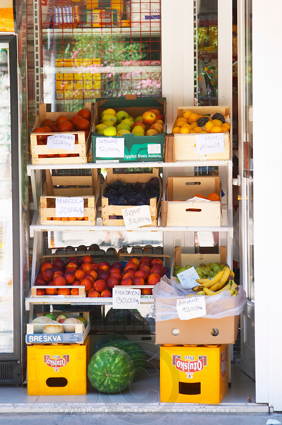 Fruit and vegetable merchant street seller shop, apples, oranges, lemons, peaches, nectarines, water melons, bananas. Uvala Sumartin bay between Babin Kuk and Lapad peninsulas. Dubrovnik, new city. Dalmatian Coast, Croatia, Europe.