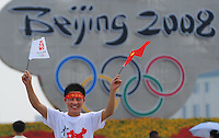 Aug. 6, 2008; Beijing, CHINA; A Chinese fan celebrates in Tiananmen Square in Beijing. The Olympics begin at 8pm on August 8, 2008. Mandatory Credit: Mark J. Rebilas-