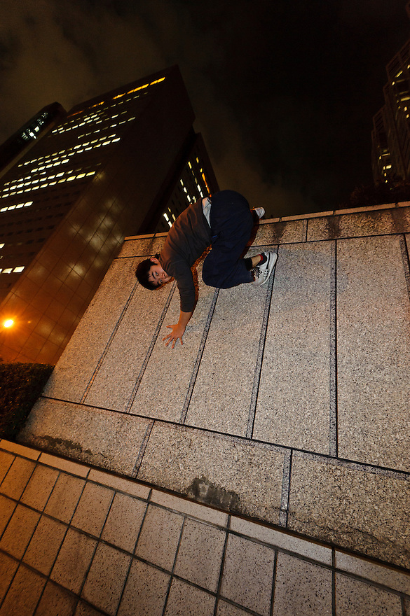 "Tokyo parkour coach and Tajikarao founder, Jun ""Sullivan"" Sato. Shinjuku, Tokyo, Japan, January 10, 2012. Parkour is a modern method of physical training, also known as freerunning. It was founded in France in the 1990s. There is a small group of around 50 parkour practitioners in Tokyo."