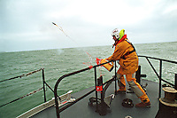Royal National Lifeboat Institution crew aboard this Severn class, all weather type lifeboat out on a rescue. One of the crew is firing a Speedline 250 rescue line from the bow to a ship in distress. This image may only be used to portray the subject in a positive manner..©shoutpictures.com..john@shoutpictures.com