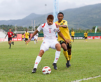 Jevani Brown (14) of Jamaica tries to take the ball away from Roberto Chen (5) of Panama during the third place game of the CONCACAF Men's Under 17 Championship at Catherine Hall Stadium in Montego Bay, Jamaica. Panama defeated Jamaica, 1-0.