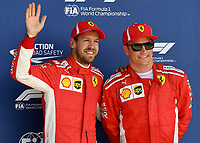 SEBASTIAN VETTEL (GER) of Scuderia Ferrari and KIMI RÄIKKÖNEN (FIN) of Scuderia Ferrari during The Formula 1 2018 Rolex British Grand Prix at Silverstone Circuit, Northampton, England on 8 July 2018. Photo by Vince  Mignott.