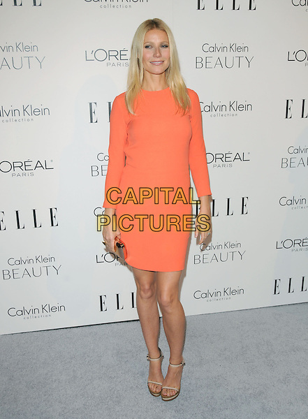 GWYNETH PALTROW .walks the carpet as Elle Honors Hollywood's Most Esteemed Women in the 17th Annual Women in Hollywood Tribute held at The Four Seasons Beverly Hills in Beverly Hills, California, USA, October 18th 2010..full length dress long sleeve sandals beige wooden sole platform orange clutch bag                           .CAP/RKE/DVS.©DVS/RockinExposures/Capital Pictures.
