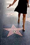Woman wlaking along Hollywood Boulevard's Walk of Fame