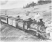 RGS 2-8-0 #41 emerging northbound from Lizard Head snowsheds with CCC consist.  Otto Perry's 1935 Ford is at the crossing.<br /> RGS  Lizard Head, CO  Taken by Perry, Otto C. - 6/30/1940