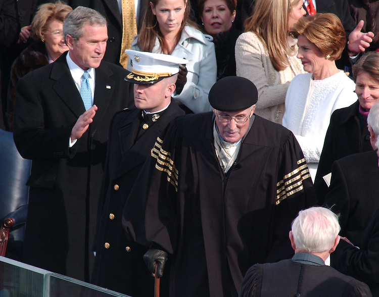 01/20/05.PRESIDENTIAL INAUGURATION--President George W. Bush looks on as Supreme Court Chief Justice William H. Rehnquist arrives on the platform to swear in President Bush to his second term..CONGRESSIONAL QUARTERLY PHOTO BY SCOTT J. FERRELL