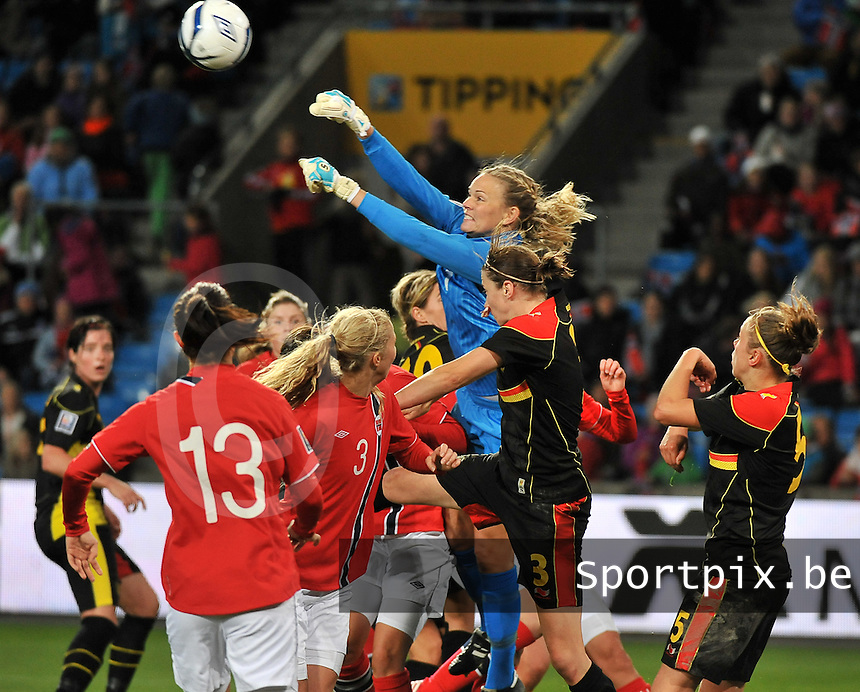 20130925 - OSLO , NORWAY : Norwegian goalkeeper Ingrid Hjelmseth pictured boxing the ball away in front of Belgian Heleen Jaques (3)  during the female soccer match between Norway and Belgium , on the second matchday in group 5 of the UEFA qualifying round to the FIFA Women World Cup in Canada 2015 at the Ullevaal Stadion , Oslo . Wednesday 25th September 2013. PHOTO DAVID CATRY
