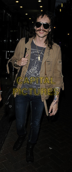 "JUSTIN HAWKINS .At the ""Psychosis"" UK Film Premiere, Prince Charles cinema, Leicester Square, London, England, UK, .July 13th 2010..full length sunglasses facial hair moustache mustache jeans beige jacket grey gray t-shirt tattoos .CAP/CAN.©Can Nguyen/Capital Pictures."