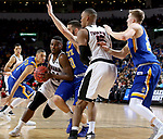 SIOUX FALLS, SD: MARCH 7: Tra-Deon Hollins #24 from Omaha drives the lane against Michael Orris #50 from South Dakota State University during the Men's Summit League Basketball Championship Game on March 7, 2017 at the Denny Sanford Premier Center in Sioux Falls, SD. (Photo by Dave Eggen/Inertia)