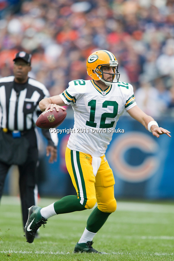 Green Bay Packers quarterback Aaron Rodgers (12) throws a pass during a week 3 NFL football game against the Chicago Bears on September 25, 2011 in Chicago. The Packers won 27-17. (AP Photo/David Stluka)