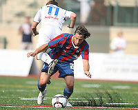 Santiago Fusilier #21 of Crystal Palace Baltimore flips Leonardo DiLorenzo #11 of the Montreal Impact during an NASL match at Paul Angelo Russo Stadium in Towson, Maryland on August 21 2010. Montreal won 5-0.