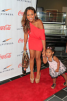 Christina Milian, daughter Violet at the Grand Opening Celebrity VIP Reception of the FIRST SIGNATURE LA FITNESS CLUB, Woodland Hills, Los Angeles, California, 02.06.2012...Credit: Martin Smith/face to face /MediaPunch Inc. ***FOR USA ONLY***