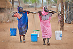 Two women carry water in the Kaya Refugee Camp in Maban County, South Sudan. The camp shelters thousands of refugees from the Blue Nile region of Sudan, and Jesuit Refugee Service, with support from Misean Cara, provides educational and psycho-social services to both refugees and the host community.