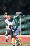 Manhattan Beach, CA 10/24/13 - unidentified Mira Costa player(s) and Paxton Shive (Peninsula #24) in action during the Palos Verdes Peninsula and Mira Costa Junior Varsity Football game at Mira Costa High School.