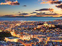 Athens after sunset with a view of the Parthenon on the Acropolis, the Parliament and the Saronic islands in Greece