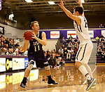 SIOUX FALLS, SD - DECEMBER 31: Zach Wessels #11 from the University of Sioux Falls looks to make a pass around  Steven Schaefer #24 from Augustana University during their game Sunday afternoon December 31, 2017 at the Stewart Center in Sioux Falls, SD.  (Photo by Dave Eggen/Inertia)