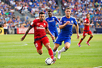Ezequiel Lavezzi (11) of Paris Saint-Germain is marked by Gary Cahill (24) of Chelsea FC. Chelsea FC and Paris Saint-Germain played to a 1-1 tie during a 2012 Herbalife World Football Challenge match at Yankee Stadium in New York, NY, on July 22, 2012.