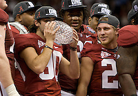 Jeremy Shelley of Alabama kisses National Championship trophy after defeating LSU during BCS National Championship game at Mercedes-Benz Superdome in New Orleans, Louisiana on January 9th, 2012.   Alabama defeated LSU, 21-0.