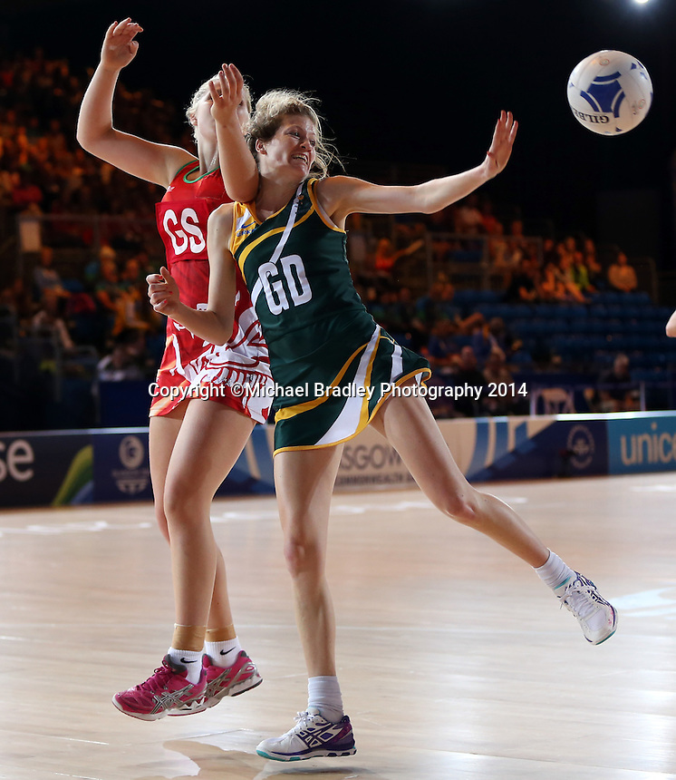 29.07.2014 South Africa's Karla Mostert in action during the South v Wales netball match at the Commonwealth Games Glasgow Scotland on the 29th of July 2014. Mandatory Photo Credit ©Michael Bradley.
