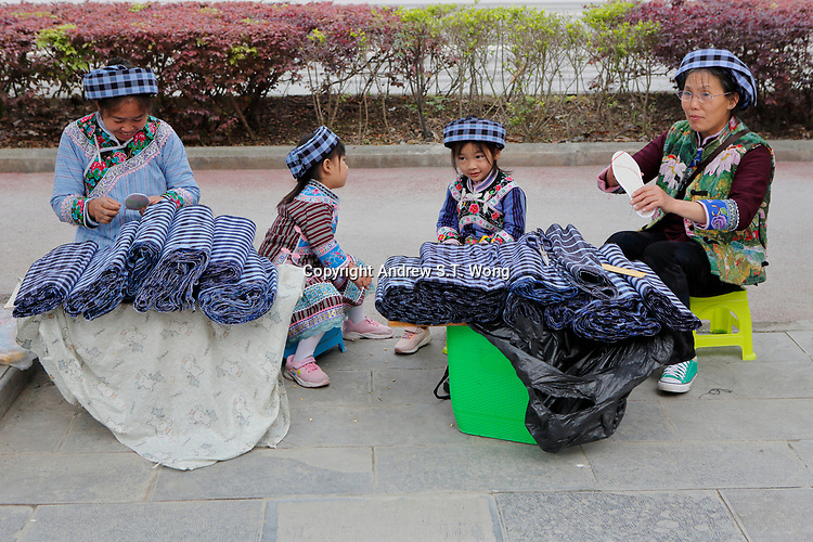 Vendors the ethnic Bouyei Tribe sell traditional cloth at Wangmo County in China's southwestern Guizhou Province, April 2019.