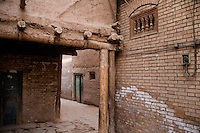 Uighurs walk through the alleyways of the Old City in Kashgar, Xinjiang, China. If 2009 government plans are followed, a majority of the Old City will be demolished to make way for new high-rise apartment blocks.