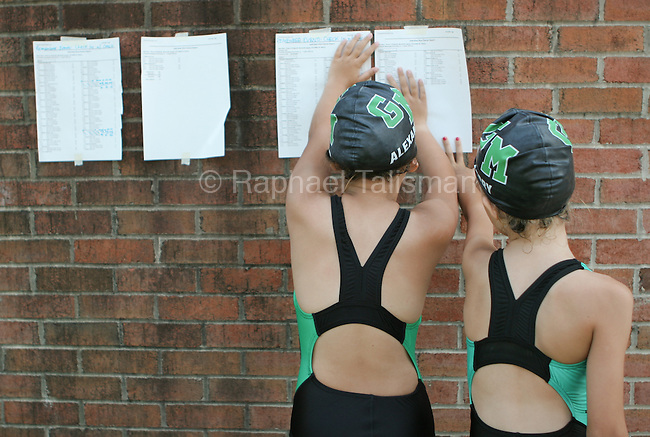 Swimmers from Greenbelt Aquatic Center look at meet results during the Maryalnd All-Stars Swim Meet in Greenbelt.