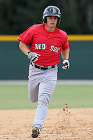 Boston Red Sox second baseman Sean Coyle #16 rounds the bases after hitting a home run during an Instructional League game against the Baltimore Orioles at Buck O'Neil Complex in Sarasota, Florida;  October 6, 2011.  (Mike Janes/Four Seam Images)