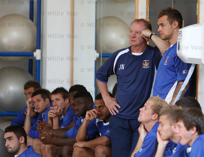 Jimmy Nicholl and Ryan O'Leary listen to instructions from the Kilmarnock physio