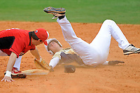 4 March 2012:  FIU outfielder Nathan Burns (6) attempts to hold onto the base while avoiding Brown's J.J. Franco (7) as the FIU Golden Panthers defeated the Brown University Bears, 8-3, at University Park Stadium in Miami, Florida.