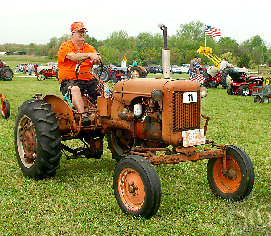 Photo by Randy Moll<br /> J.C. Tucker drives his 1953 Allis Chalmers tractor in the Parade of Power on Friday (April 14, 2017) at the Tired Iron of the Ozarks show in Gentry.