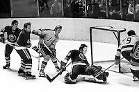 California Golden Seals Ivan Boldirev tries to sneak the puck past New York Ranger goalie,<br />
