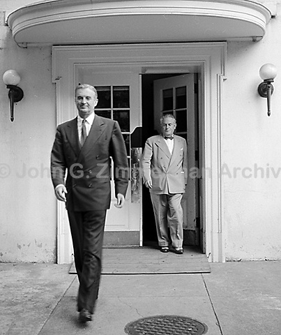 First Secretary of the Air Force Stuart Symington (Front) and Sam Rosenman leave White House after meeting with President Truman, Washington D.C> 1950. CREDIT: JOHN G. ZIMMERMAN