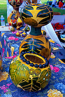 Nature-decorated Hawaiian gourds (one ringed with kukui nuts) for sale at a Kapiolani Park craft market