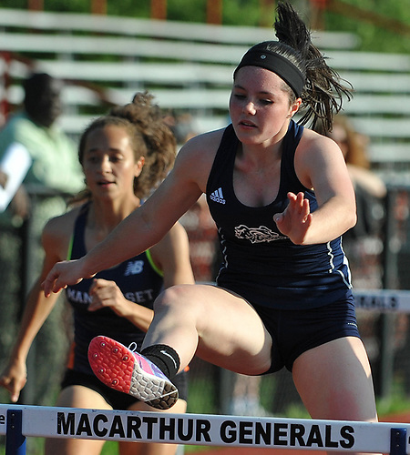 Emma Blumenstein wins the girls' 100 meter hurdles competition during the Nassau County AA track & field championship at MacArthur High School on Wednesday, May 23, 2018.